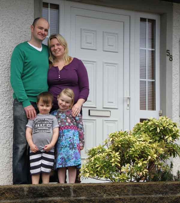Carleen, Mark and their children outside their house, which is once again up for raffle in an upcoming iCARE draw.