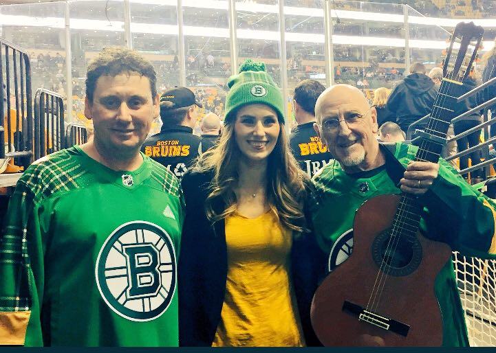Declan Houton and guitarist Chuck Parish pictured with Kerry Collins, director of community relations with the Boston Bruins.
