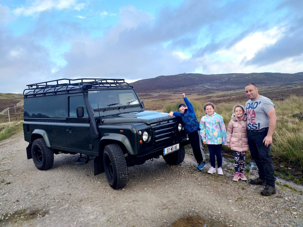Danny Doherty and his children, Max, Millie and Annie, celebrating their new Land Rover Defender