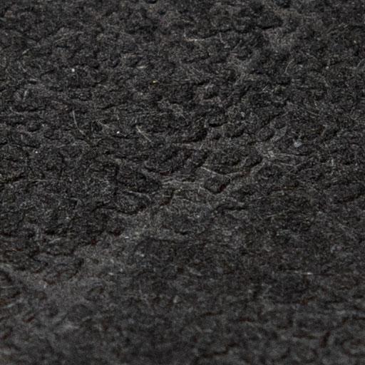 Texture d'une feuille de papier texturée noire en lumière directe et rasante