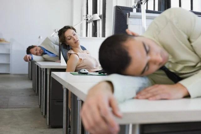 Businesspeople Sleeping on Desks