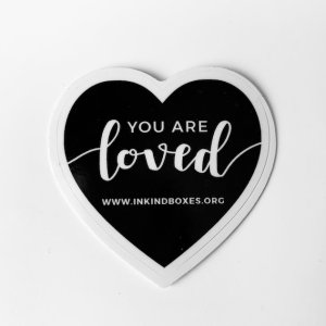 black heart sticker that says you are loved.