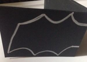 Halloween Candy Catcher, black construction paper, silver gel pen outline of bat.