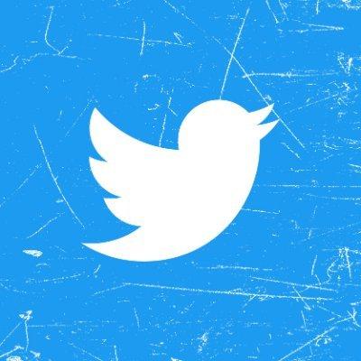 Die Vogelshilouette von Twitter auf zerkratztem Untergrund