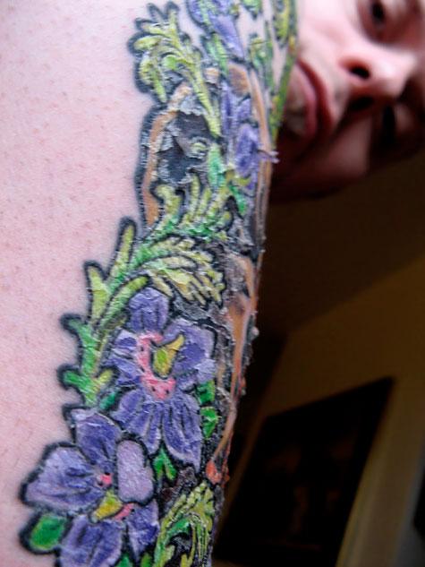 Peeling Triceratops tattoo
