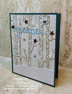Photo of Gold embossed Stampin' Up! Woodlands embossing folder with Christmas Greetings Thinlits