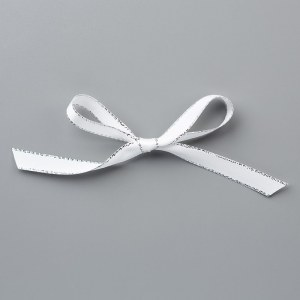 "Silver 3/8"" Metallic Edge Ribbon tied in a bow."