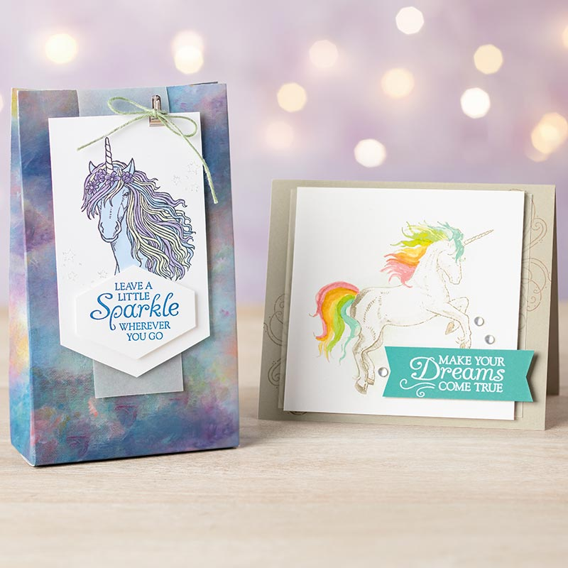 Two Leave a Little Sparkle stamp set samples: a bag with a unicorn tag and a card with a rainbow-colored dancing unicorn!