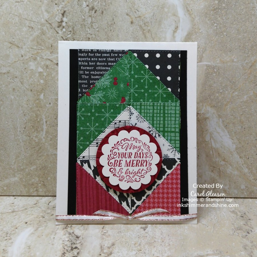 Black and white, green, and red patterned papers are die cut with the Stampin' Up! Stitched Triangles Dies. These triangles are arranged in a pattern to create the focal pattern of this Christmas card.