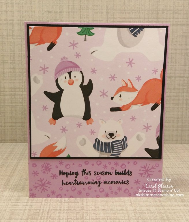 """Penguin Playmates Day 4 Vertical Layout 2. Penguin Playmates paper is accented with a 1/8"""" black border. Snowflakes are stamped in Fresh Freesia ink to coordinate with the snowflakes in the paper background."""