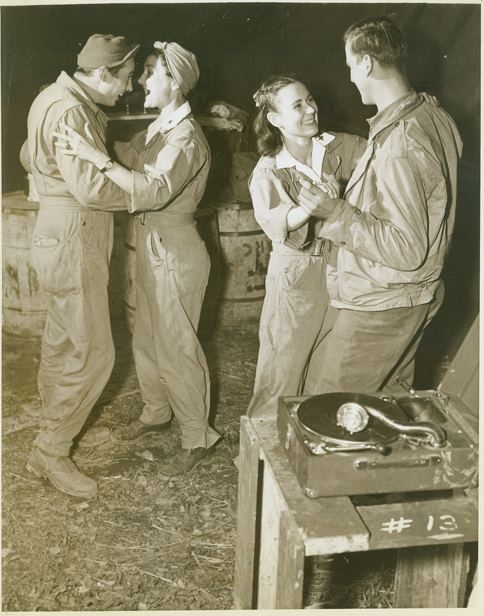 Red cross girls dancing with soldiers