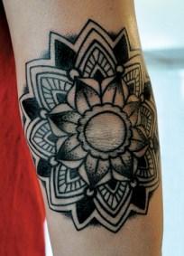 grey-ink-mandala-elbow-tattoo