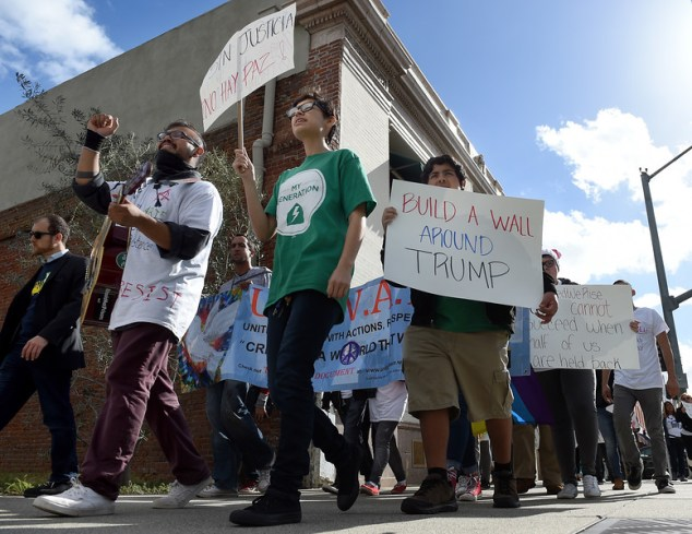 "About 200 protestors march through downtown during a ""United Against the Trump Agenda"" event in Ontario, CA., Saturday, January 21, 2017. (Staff photo by Jennifer Cappuccio Maher/Inland Valley Daily Bulletin/SCNG)"
