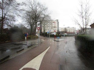 The view looking east at the point where the bikeway crosses Kennedylaan. The intersection is a raised table that makes bikeway priority clear.