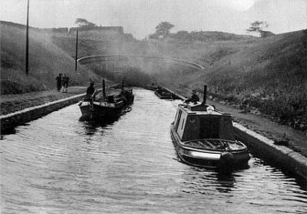 Tug 5 (Bittell) just coming out of the southern end of Netherton Tunnel towing a train of loaded joey boats. Circa 1950's