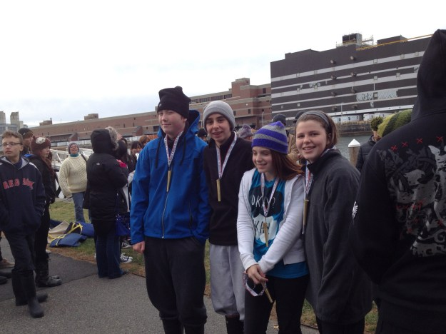 Team Inly, John McNeil, Charlie McDonald, Ali Faulkner, Caroline Leta, pose with their metals