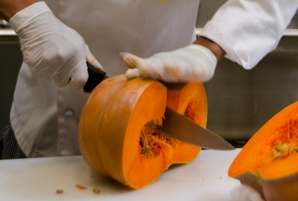Prepping pumpkins at Angel Heart Bakery