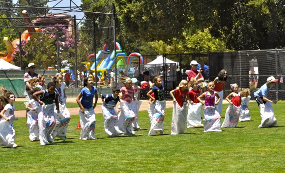 Potato sack races at Menlo Park 4th of July celebration