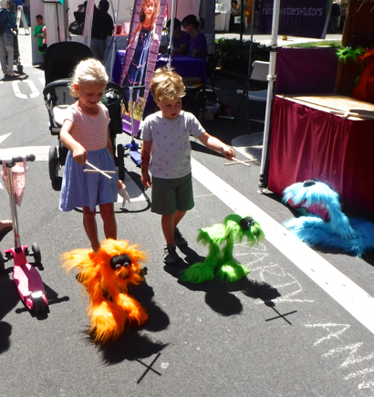 Kids with feather puppets