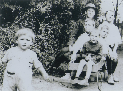 Grandpa (in hat) and his little brothers, about 1920 in Canada