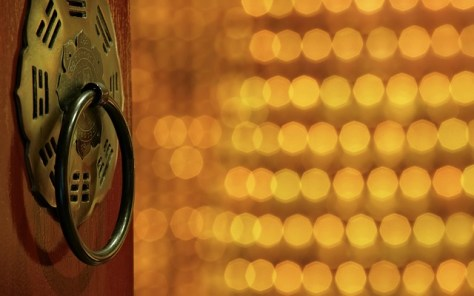 door knocker surrounded with gold light, for family constellation facilitator training