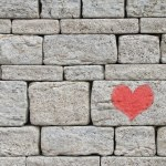 heart on stone wall