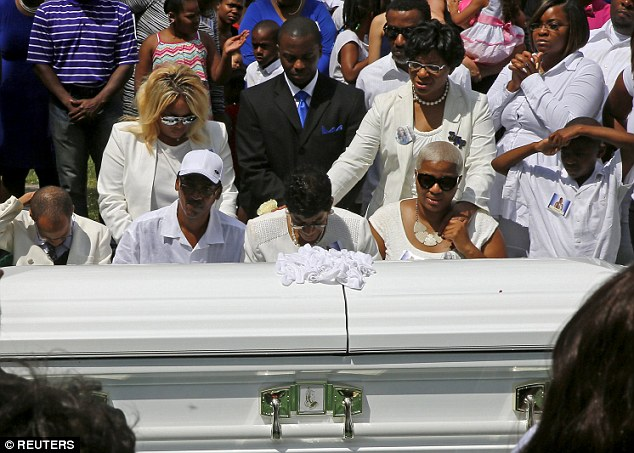 Shante Needham (third right, seated) and Sharon Cooper (fourth right, standing), sisters of Sandra Bland, and Bland's mother Geneva Reed-Veal (centre) at Bland's funeral in the Chicago suburb of Willow Springs, Illinois, on July 25