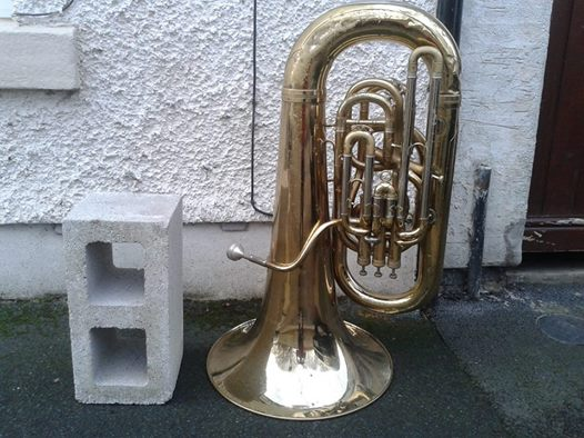 a hollow core concrete building block and a tuba