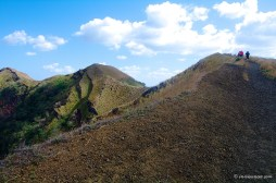 From the central crater it is possible to start hiking to other craters and viewpoints. Walk up a bit to get a view of the smoking volcano and the fascinating surroundings.