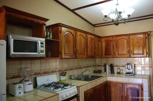 Kitchen is equipped with microwave and 4 burner gas stove with oven.