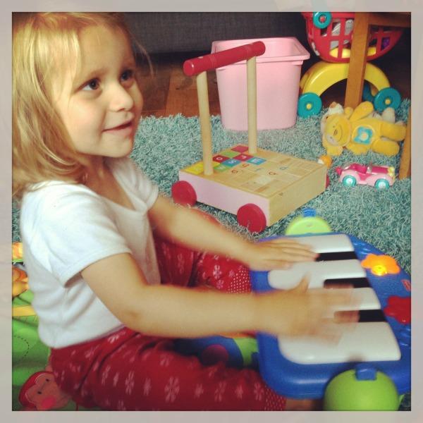 Addison_playing_fisherprice_playgym