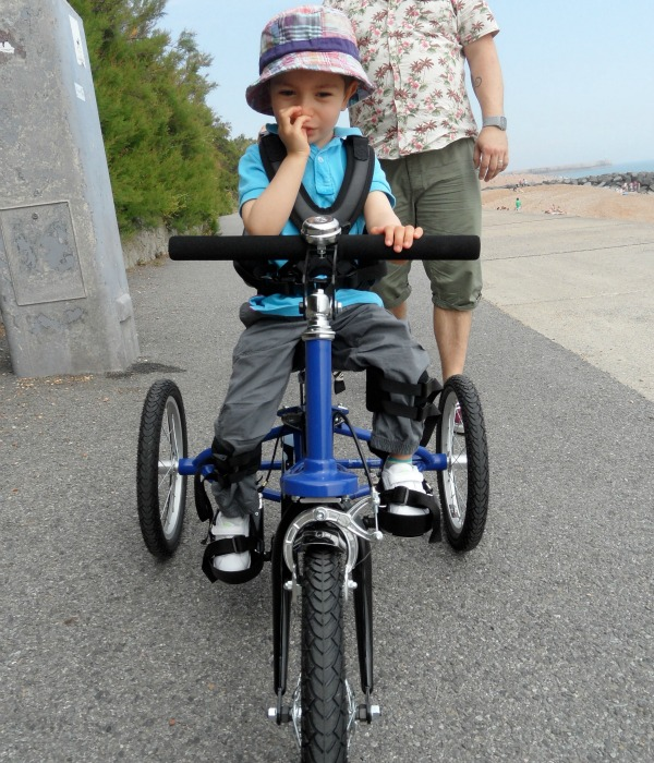 grayson on his special needs trike