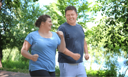 Man and Woman jogging in the park 1