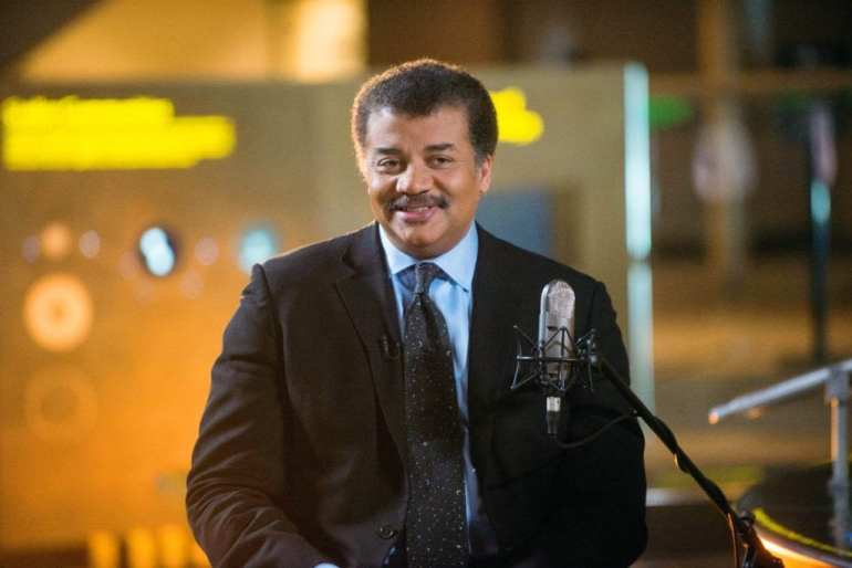 """Neil deGrasse Tyson on the set of his new talk show series """"StarTalk"""" filmed with a live studio audience in the Hayden Planetarium at the American Museum of Natural History. """"Star Talk"""" premieres on National Geographic Channel in April. (photo credit:  National Geographic Channels/Scott Gries)"""