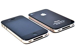 Photograph of two 32GB Black iPhone 4s. The ph...