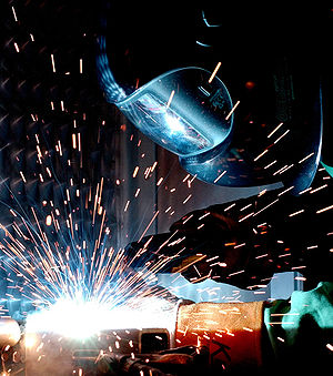 A man gas metal arc welding.