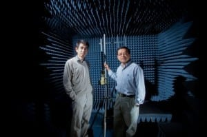 From left, Yingbo Hua and Ping Liang stand in the anechoic (non-echoing) radio frequency chamber where they conduct research. Photo credit: Peter Phun.