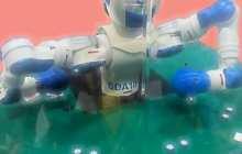 Robot plays blackjack dealer at Automate 2013