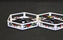 Watch: Autonomous Robots Self-Assemble and Take Flight as One