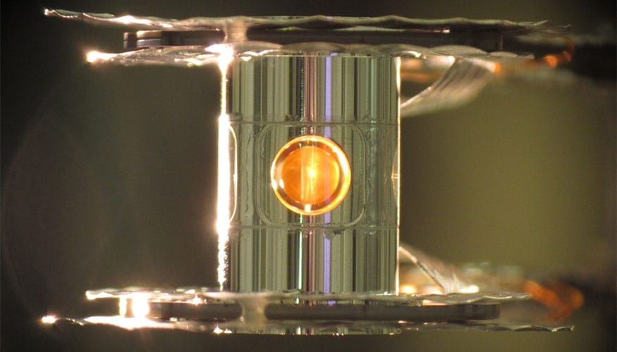 A metallic case called a hohlraum holds the fuel capsule for NIF experiments. Target handling systems precisely position the target and freeze it to cryogenic temperatures (18 kelvins, or -427 degrees Fahrenheit) so that a fusion reaction is more easily achieved. Photo by Eduard Dewald/LLNL