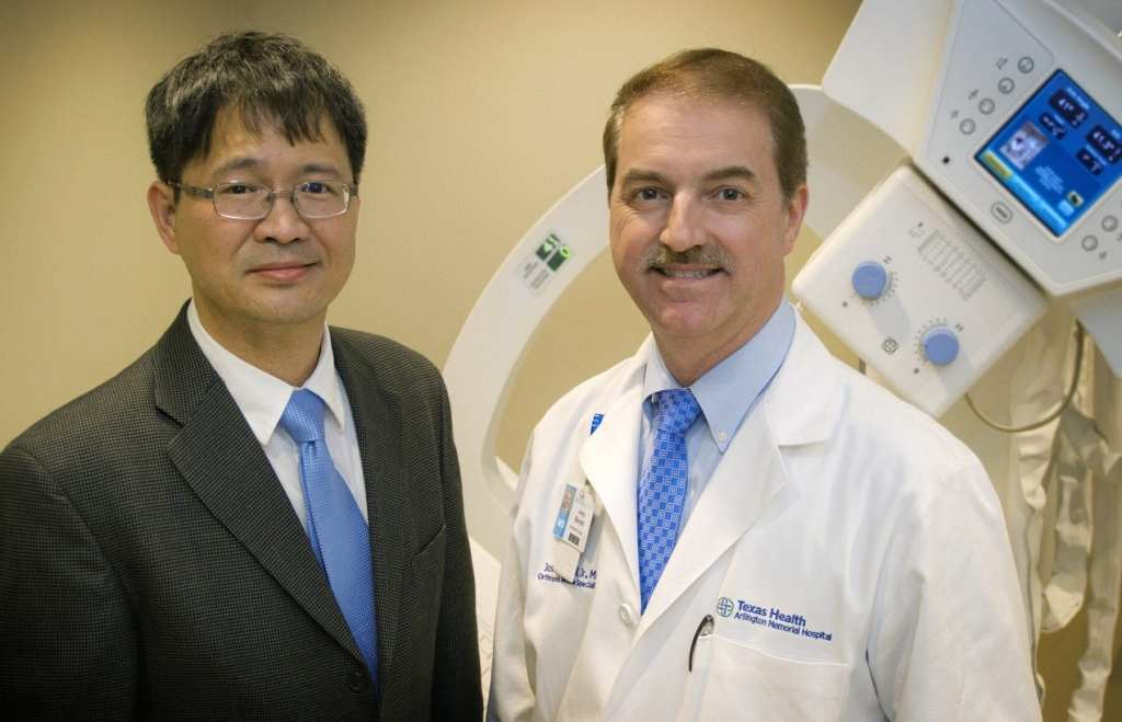 Dr. Liping Tang, left, bioengineering chair and professor, and Dr. Joseph Borrelli, chair of orthopedics for Texas Health Arlington Memorial, are lead investigators of the research project studying whether bone tissue can be created from a patient's own stem cells.