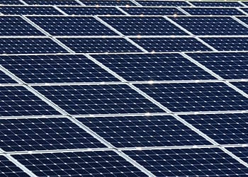 English: Guantanamo Bay, Cuba (Oct. 22, 2011) A view of solar panels being installed at Naval Station Guantanamo Bay, Cuba. The solar farm is being installed to provide electricity for the ongoing expansion of Denich Gym at the naval station's Cooper Field sports complex. (U.S. Navy photo by Chief Mass Communication Specialist Bill Mesta/Released) (Photo credit: Wikipedia)