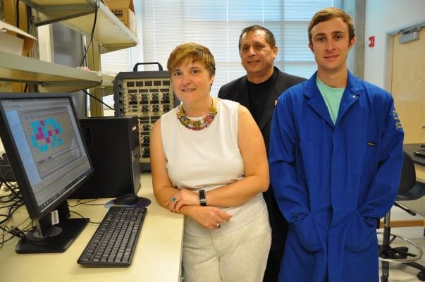 From left, Mihrimah Ozkan, Cengiz Ozkan and Zachary Favors in the Ozkan's lab.