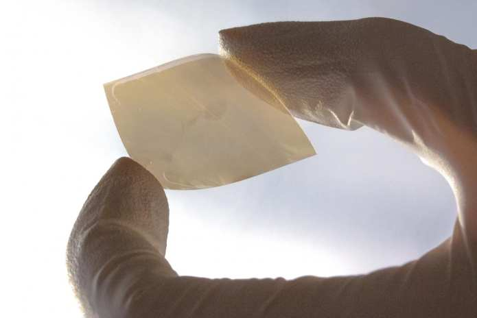This is a photograph of a single-flake-layer WSe2 thin film deposited on flexible Sn:In2O3 (ITO)-coated PET plastic. CREDIT Kevin Sivula (EPFL)