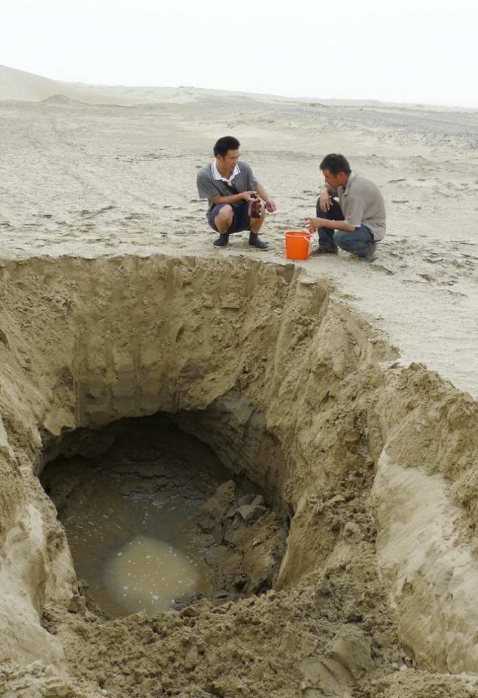 Researchers gathered groundwater flowing under the desert sands. The amount of carbon carried by this underground flow increased quickly when the Silk Road, which opened the region to farming, began 2,000 years ago. Credit: Yan Li