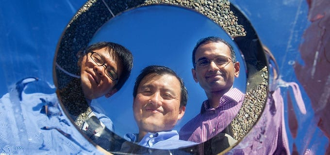 Doctoral student Linxiao Zhu, electrical engineering professor Shanhui Fan and research associate Aaswath P. Raman are Stanford engineers who have developed a thermal overlay to cool solar cells. Credit Stanford Engineering
