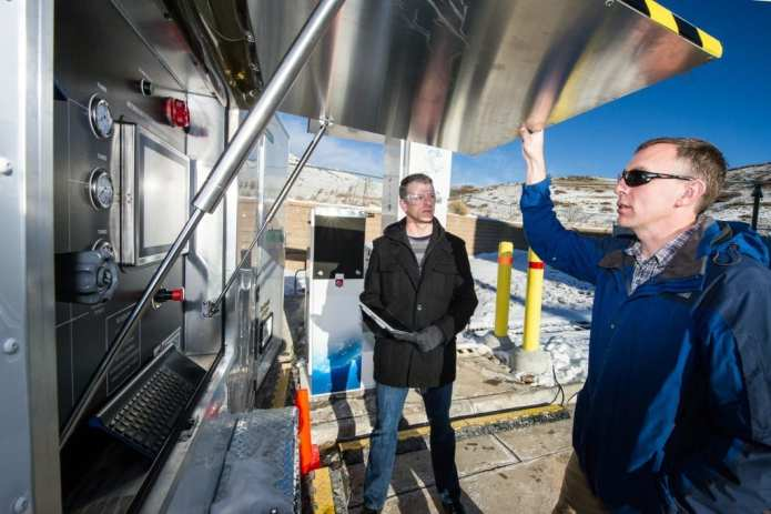 December 1, 2015- L-R, Terry Johnson, Sandia Lab, Project Lead and NREL researcher Chris Ainscough work on the Hydrogen Station Equipment Performance (HyStEP) device at the Energy Systems Integration Lab at NREL in Golden, CO. HyStEP is designed to facilitate the commissioning of hydrogen stations by testing their ability to meet the SAE J2601 fueling protocol. (Photo by Dennis Schroeder / NREL)