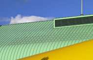 Could rooftops covered in plastic grass could one day power your home with wind energy?