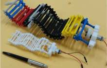 First wave-propelled robot swims, crawls and climbs using a single, small motor