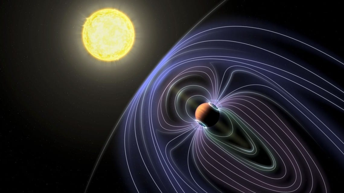 Jack Madden/Cornell University In this artistic rendering of the Tau Boötes b system, the lines representing the invisible magnetic field are shown protecting the hot Jupiter planet from solar wind.